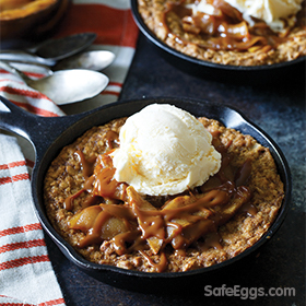 This caramel apple oatmeal pizookies recipe is perfect for fall. Serve with ice cream for a delicious fall treat.